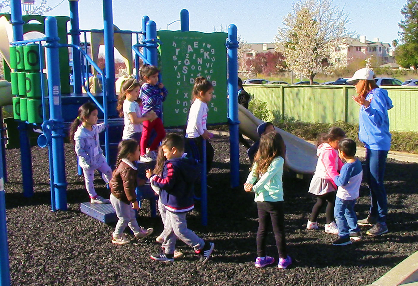 Group of preschoolers at the park with their teacher