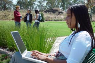 Student on laptop outside