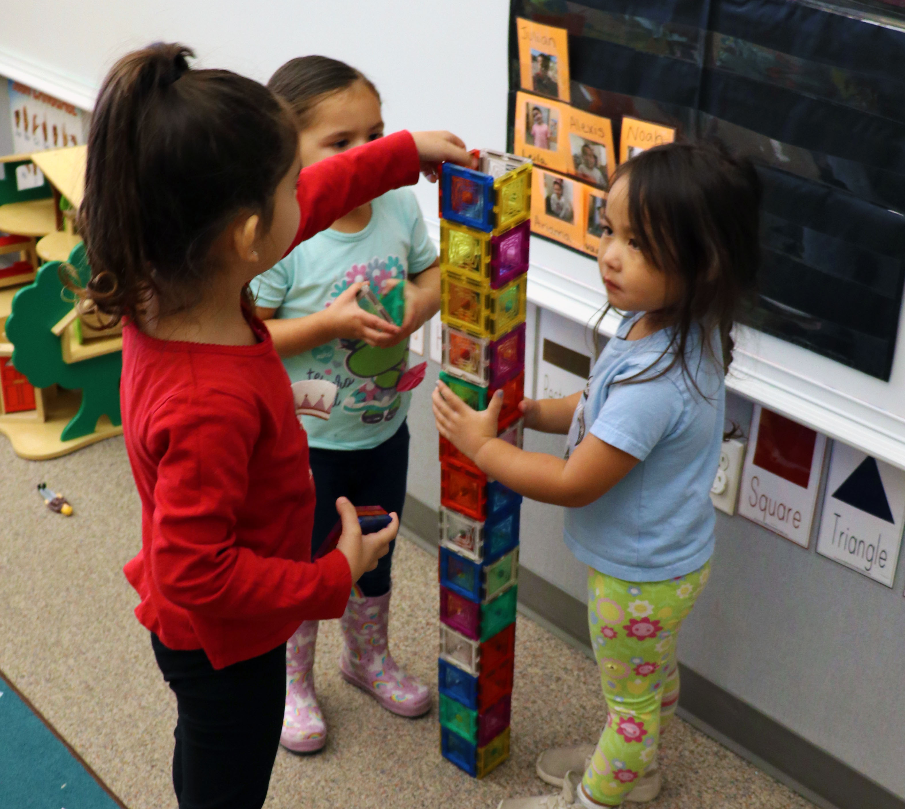 Girls building magnetic tower
