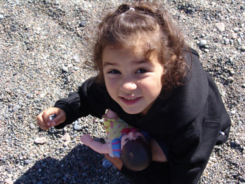 Girl playing with rocks