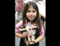 Little girl holding her recycle bots