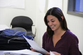 Graduate Studies student smiling in classroom