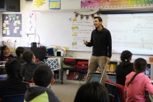 Teacher and students in elementary school class