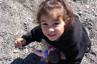 Little girl is holding rocks
