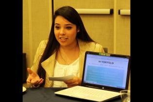 Student presenting her final portfolio to peers